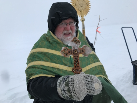 Blessing the water. The cross became quickly crusted with ice.