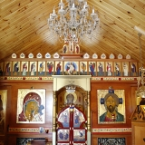 Icons on the walls are done in a traditional way that generally conforms to all other icons within the Russian Orthodox Church.
