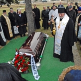 Archbishop Irenée censes the remains of Archimandrite Alexander surrounded by clergy