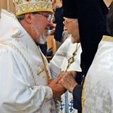 Archbishop Irenée greets Metropolitan John