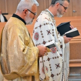 Deacon John & Father Gregory recite prayers during Liturgy