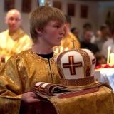 Altar server Herman Campbell presenting mitre at episcopal vesting.